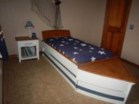 for added storage space. The bed disasembles into