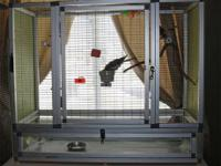 Custom made flight cage sits on a credenza or table,