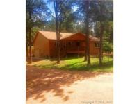 CUSTOM MAIN LEVEL/RANCH HOME ON A BEAUTIFUL 1/2 ACRE