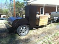 "custom pig cooker with 22"" wheels, sinks, warming box,"