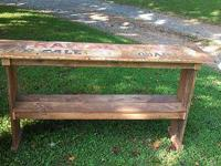 This table was constructed from reclaimed white oak and