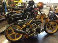 "2009 custom rigid frame chopper with S&S 100"" motor and"
