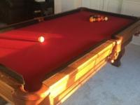 Custom slate made pool table with black bumpers.