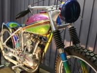 This is an award winning 1960 custom Triumph Tiger Cub.
