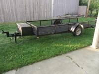 Custom made utility trailer. Comes with ladder racks