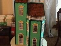 3-level wooden Victorian townhouse-style dollhouse. 40""