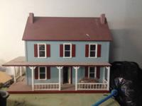 Large wooden dollhouse to design on your own. Hand