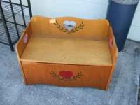 This is a cute all wood toy or storage box and bench in