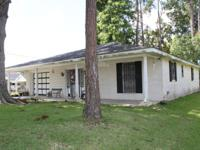 Cute home in Thibodaux with beautiful trees in thefront