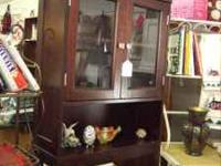 This cute dark wood/glass cabinet is only $50.00 (Booth