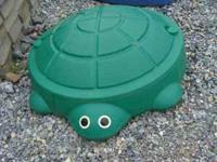This is a cute turtle sandbox in excellent condition.