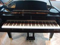 A Beautiful Polished Ebony Grand Piano - fantastic