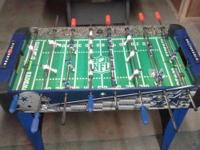 We have a kool kid size Dallas Cowboys foosball table