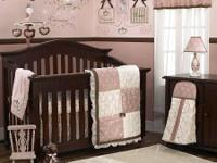 Very pretty baby girl crib bedding. Pink, browns and