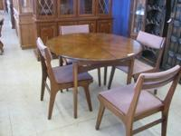 This 44 inch round table has beautiful matched walnut
