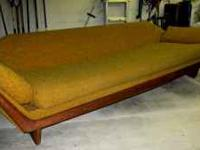 This Danish Modern sofa is in fair condition. It is