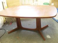 Teak table with attached canvas sling Holds magazines