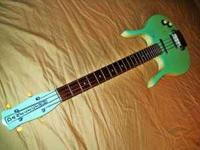 Seafoam Green Danelectro Longhorn Bass with gig bag.