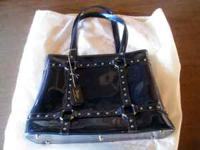 Up for sale is an extra large dark blue Beijo purse /