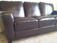 Offering an espresso colored synthetic leather sofa,