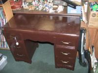 This is a beautiful dark brown desk. Asking $35. Call