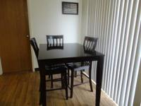 Dark Brown Kitchen table with 3 chairs very nice in