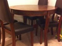 """Nice wood table (W42"""" x D42"""" x H30"""") with 4 chairs."""