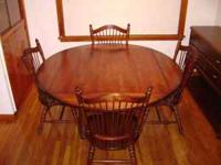 Solid cherry dining room table with 4 chairs. Table has