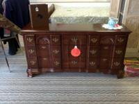 This is a Beautiful Dark Cherry Wood Dresser, that is