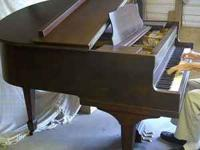 "Lyric baby grand piano, approximately 4' 10"" long."