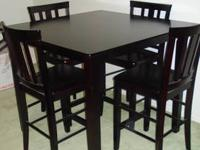 Up for sale is a dark mahogany/ Expresso dining room