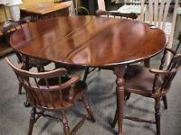 Dark Maple Dinning Table & Chairs It has 2 leafs. Minor