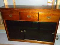 FOR SALE: Dark wood bookcase with 3 draws and 3 green