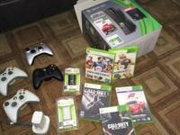 This XBOX is a year old/like new ... includes 4
