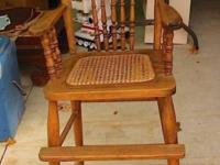 This antique strong oak youngster's high chair has a