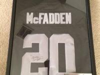 Encased, signed, authentic Darren McFadden Jersey with