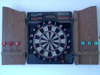 Halex electronic dart board with cabinet has 28