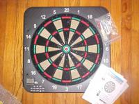 Complete brand new dartboard kit with manual and darts.
