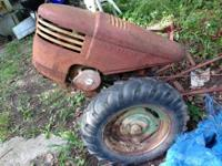 David Bradley antique walk behind tractor That has a