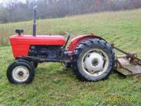 Includes 6 foot King Kutter brushhog. Both work well,