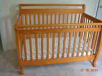delicately utilized baby crib and bed mattress. Baby