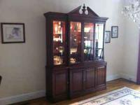 Solid mahogany breakfront. 2-piece construction,