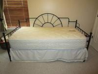 Black wrought iron daybed with mattress (Barely made
