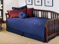 Double Twin daybed with mattresses, like new. Purchased