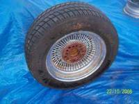 4 dayton wire knock off wheels, 2 have 225/60/15 and 2