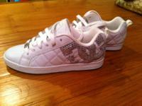 Brand New DC white sneakers with silver detail. Size 7
