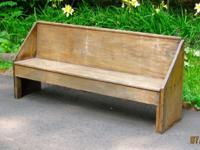 This antique primitive bench is made of cherry wood