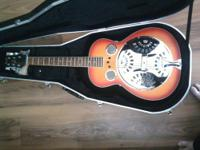 It's a Dean all mahogany square neck Dobro guitar. It