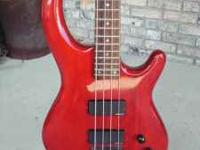 Dean bass guitar and Peavey KB60 amp. The photos are