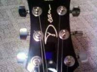 I am selling a like-new Dean Evo XM. Maple neck,